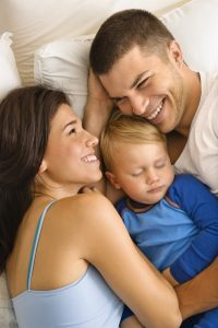 Parents and sleeping baby