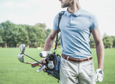 Pain and discomfort in golf, male golfer carrying bag